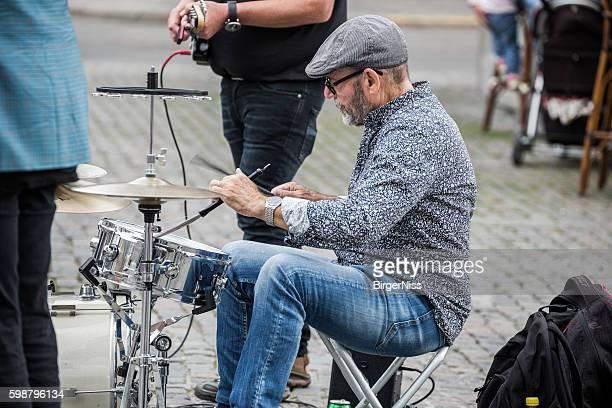 Drummer with two collegues entertaining in Nytorv, Copenhagen, Denmark