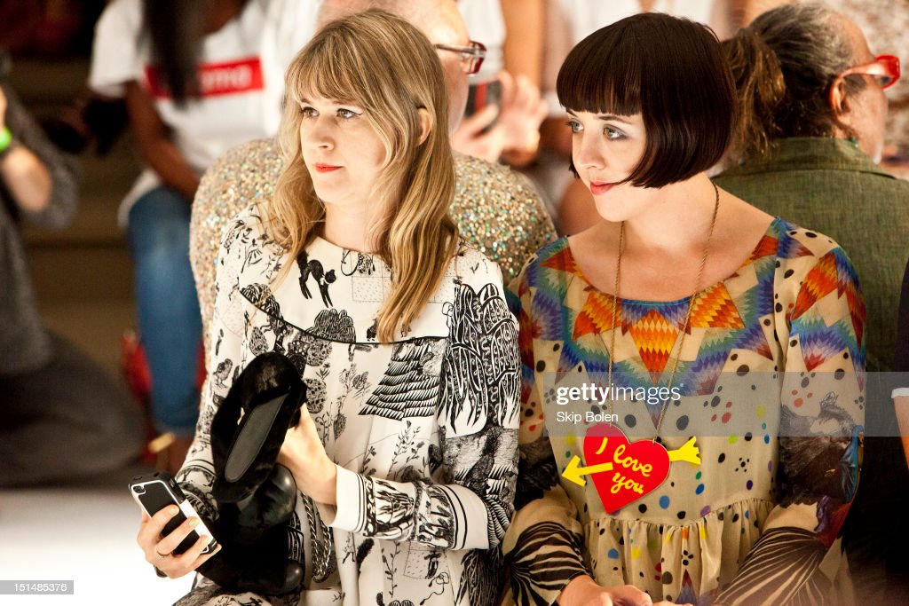 Drummer-actress Tennessee Thomas and artist-illustrator Alia Penner watch a model on the runway at the Suno spring 2013 fashion show during Mercedes-Benz Fashion Week at Milk Studios on September 7, 2012 in New York City.