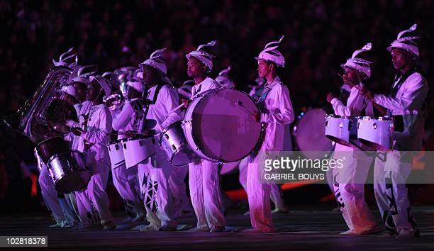 Drummers and musicians wearing Makarapas perform during the closing ceremony of the 2010 FIFA football World Cup prior to the final between the...