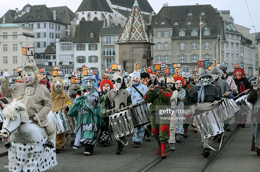 Drummers and pipers with typical masks and lanterns take part in the traditional 'Morgestraich' for the opening of the Basel Fasnacht Carnival on February 18, 2013 in Basel, Switzerland. The Fasnacht is recognized as the largest popular festival in Switzerland, with between 15,000 to 20,000 masked participants taking part. The prelude is the Morgestraich on the Monday which starts at four in the morning with groups of fifers and drumers moving through the center of town while playing carnival tunes.