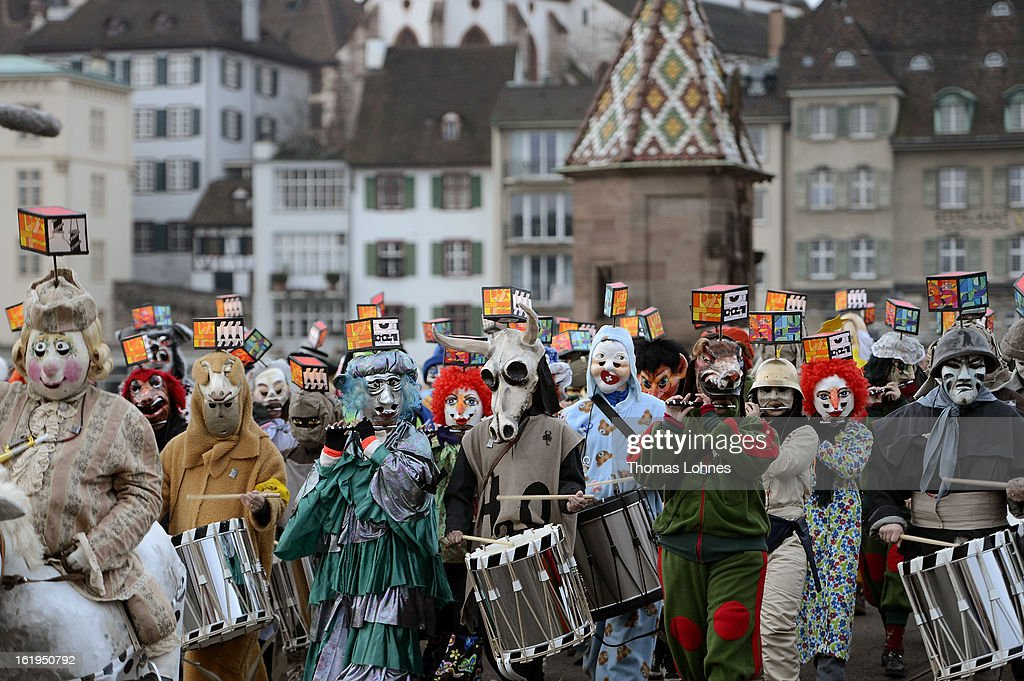 Drummers and pipers with typical masks and lanterns takes part in the traditionell 'Morgestraich' for the opening of the Basel Fasnacht Carnival on February 18, 2013 in Basel, Switzerland. The Fasnacht is recognized as the largest popular festival in Switzerland, with between 15,000 to 20,000 masked participants taking part. The prelude is the Morgestraich on the Monday which starts at four in the morning with groups of fifers and drumers moving through the center of town while playing carnival tunes.