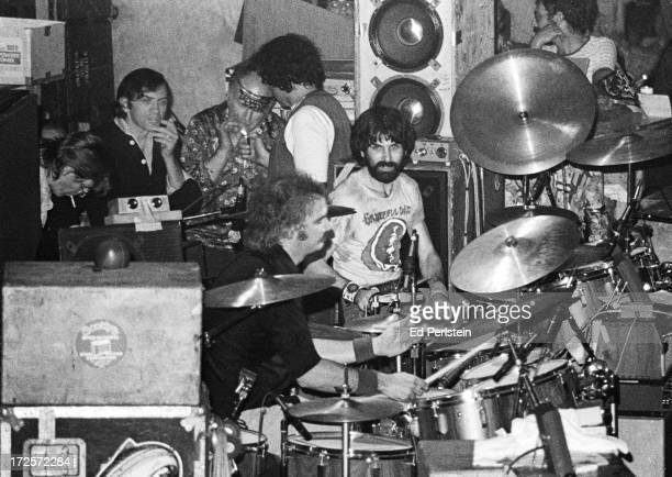 Drummers Bill Kreutzmann and Mickey Hart perform on New Years Eve 1977 with The Grateful Dead at Winterland in San Francisco California Lighting up...
