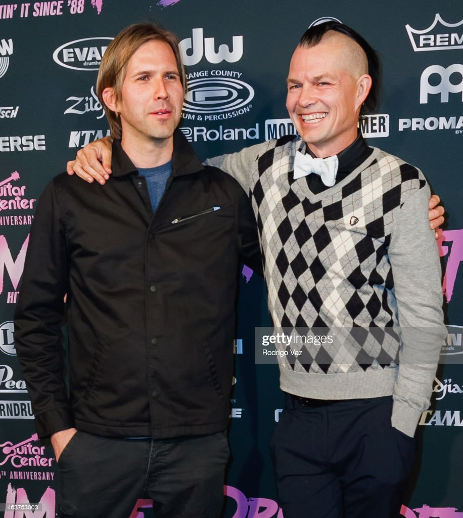 Drummers Brooks Wackerman (L) and <a gi-track='captionPersonalityLinkClicked' href=/galleries/search?phrase=Adrian+Young+-+Drummer&family=editorial&specificpeople=213613 ng-click='$event.stopPropagation()'>Adrian Young</a> attend the Guitar Center's 25th Annual Drum-Off Grand Finals at Club Nokia on January 18, 2014 in Los Angeles, California.