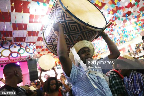 Drummers from the BeijaFlor samba school prepare to perform during a traditional Festas Juninas party at the Salgueiro samba school on June 18 2017...