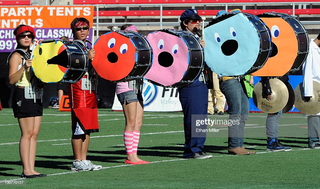 Drummers in the UNLV Rebels band dressed up as Ms. Pac-Man perform before the team's game against the Colorado State Rams at Sam Boyd Stadium October 29, 2011 in Las Vegas, Nevada.