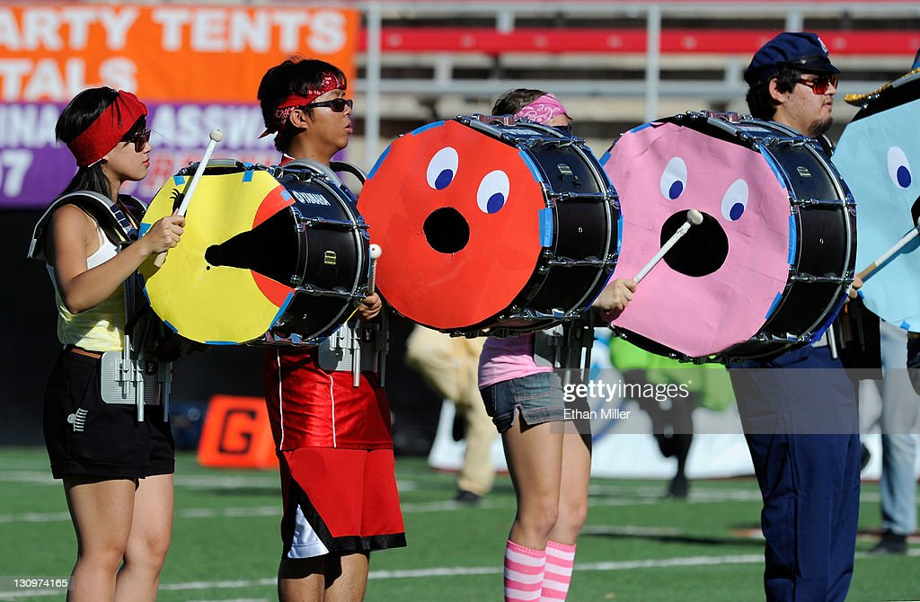 Drummers in the UNLV Rebels marching band, dressed up as Ms. Pac-Man for Halloween, perform before the team's game against the Colorado State Rams at Sam Boyd Stadium October 29, 2011 in Las Vegas, Nevada.