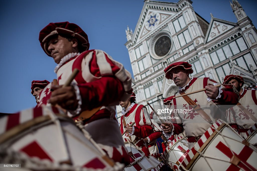 Drummers in traditional dress march before the final match of The Calcio Storico Fiorentino between the Santo Spirito Bianchi (White) Team and the La Santa Croce Azzuri (Blue) Team at the La Santa Croce square on June 24, 2016 in Florence, Italy. The Calcio Storico (Historical Football in English) Fiorentino is an early form of football, originating in the 1500's. It is a combination of football, rugby and wrestling. Now, annually during a weekend in early June, four teams representing the districts of Florence face each other in the first semi-finals. The winners go to the final, played every year on June 24, the day of the patron of Florence, St. John the Baptist. The official rules of calcio (football) were written for the first time in 1580 by Giovanni de Bardi, a count from Florence. The teams are formed by 27 players and the ball can be played either with hands or feet. Tactics such as punching, elbowing and all martial arts techniques are allowed but kicks to the are forbidden, as are fights of two or more against one. There is a referee, a field master, and six linesmen. The game lasts 50 minutes, and the winning team is the one who scores most points. The playing field is a giant sand pit with a narrow split constructing the goal running the width of each end. The Calcio Storico was not played for 200 years, until its revival in 1930.