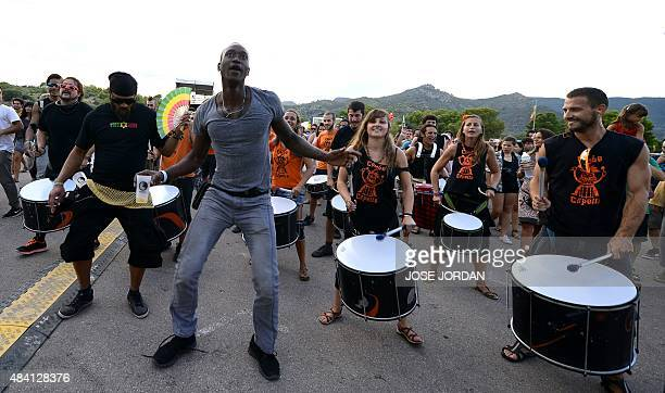 Drummers perform during a concert at the Rototom Sunsplash Reggae festival in Benicassim Castellon province on August 14 2015 Rototom runs from...