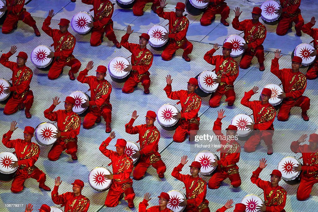 Drummers perform during the Opening Ceremony for the 16th Asian Games Guangzhou 2010 at Haixinsha Square on November 12, 2010 in Guangzhou, China.