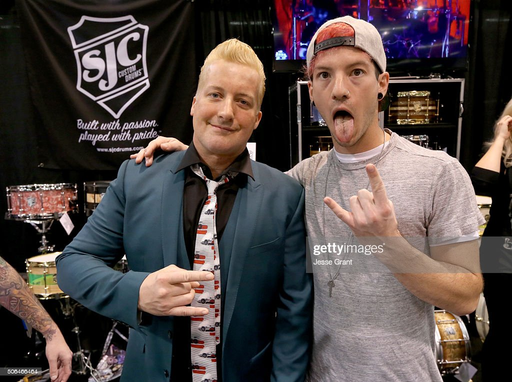 Drummers Tre Cool and Josh Dun pose for a pciture during day 3 of the 2016 NAMM Show at the Anaheim Convention Center on January 23 2016 in Anaheim...