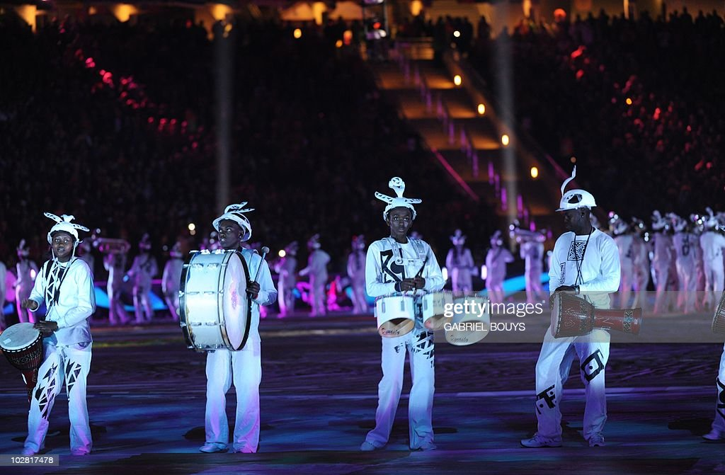 Drummers wearing Makarapas perform during the closing ceremony of the 2010 FIFA football World Cup prior to the final between the Netherlands and...