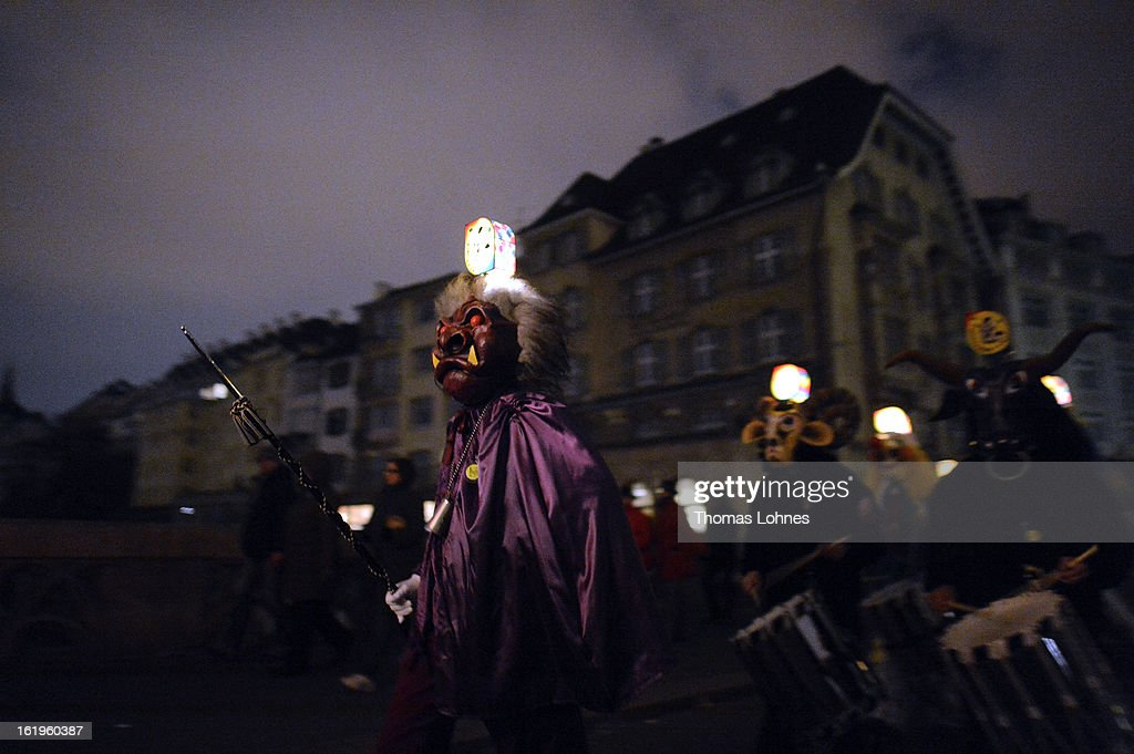 Drummers with typical masks and lanterns take part in the traditional 'Morgestraich' for the opening of the Basel Fasnacht Carnival on February 18, 2013 in Basel, Switzerland. More than 12,000 participants will take part in the largest carnival in Switzerland that lasts for 72 hours and will be watched by more than 100,000 spectators as it makes its way through the city center.