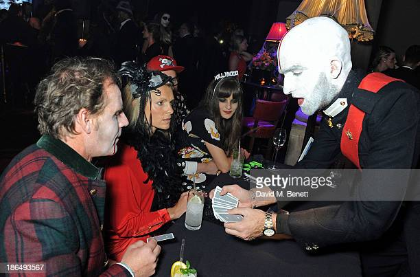 Drummond MoneyCoutts performs magic for guests at the UNICEF UK Halloween Ball hosted by Jemima Khan raising vital funds for UNICEF's work for...
