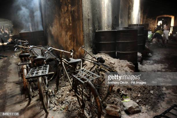 Drums containing boiling water are used to disinfect hospital washing as washers known locally as Dhobis work in the open to wash clothes from...