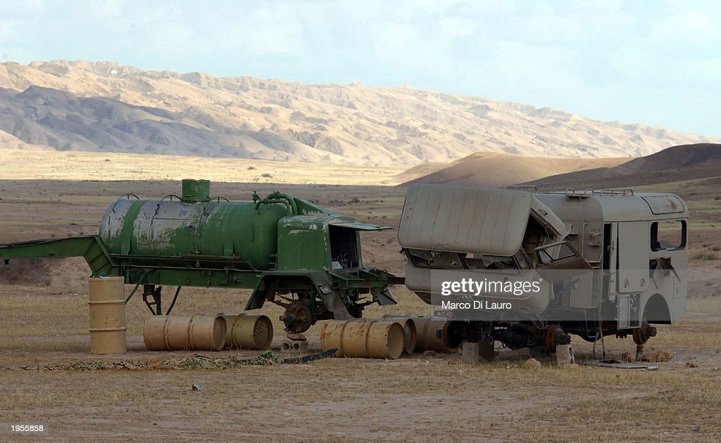 Drums sit next to a pumping system and a mobile laboratory April 28 2003 after being discovered by US troops in the outskirts of Baiji in northern...