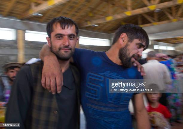 Drunk afghan men in the market border with Afghanistan where alcohol can be bought Central Asia Ishkashim Tajikistan on August 6 2016 in Ishkashim...