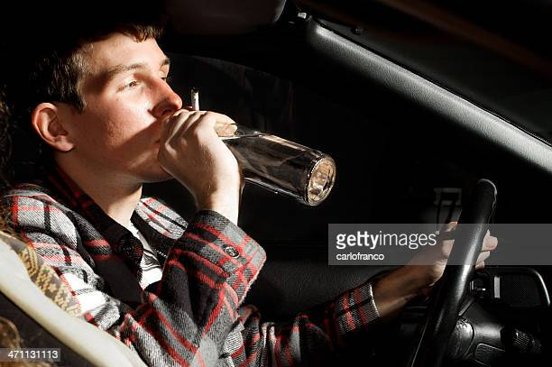 Drunk man drinking while driving