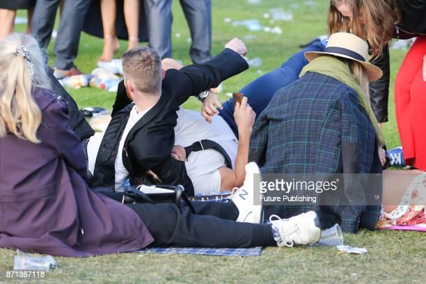 Drunk punters wrestle at the end of the day arrive at the Melbourne Cup Carnival on November 7 2017 in Melbourne Australia Chris Putnam / Barcroft...