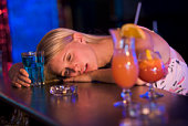 Drunk young woman passed out in bar
