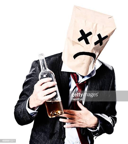 Drunken businessman in paper-bag mask regrets his actions