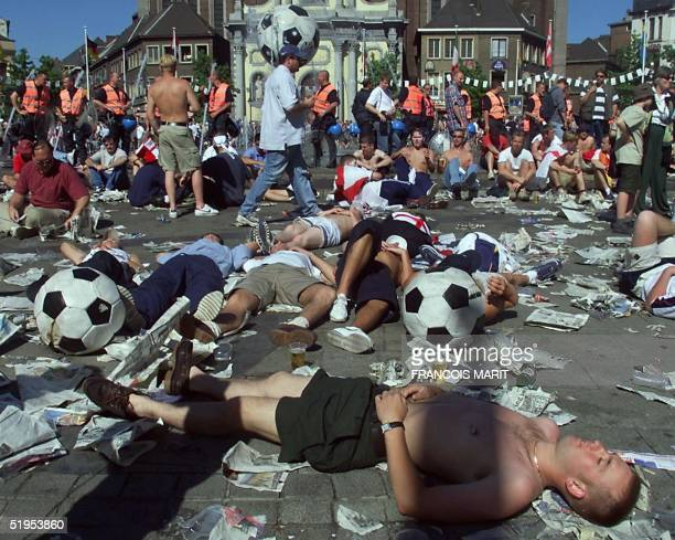 Drunken football fans rest on Charleroi Charles II square 17 June 2000 in Charleroi a few hours before the Euro 2000 first round match between...