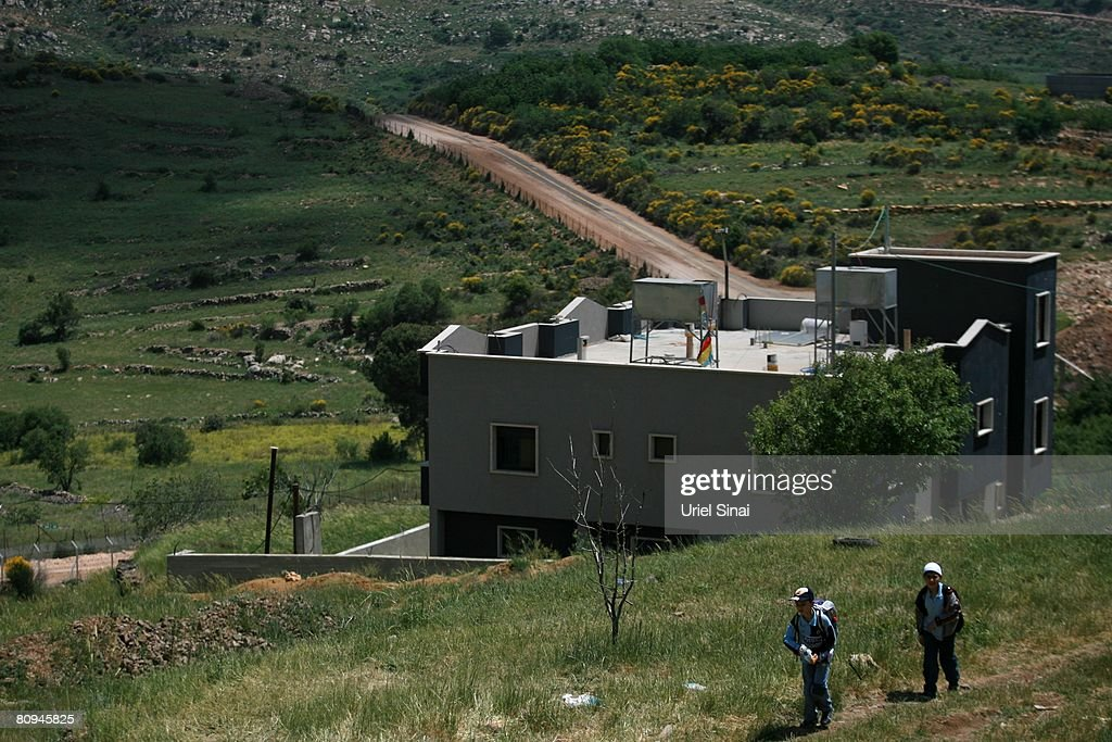 Druze children pass the Israeli Syrian border on their way home from school on April 29 2008 in Majdal Shams in the Golan Heights Residents of this...