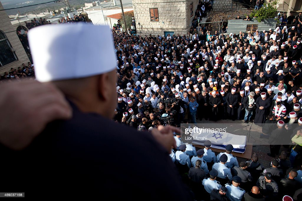 Druze men and relatives attend the funeral of Druze Israeli police officer Zidan Sif on November 19 2014 Druze village of YanuhJat Israel Sif died of...