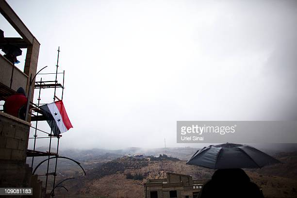 Druze men look at the Syrian side of the border during a rally at the village of Majdel Shams near the border between Israel and Syria on February 14...