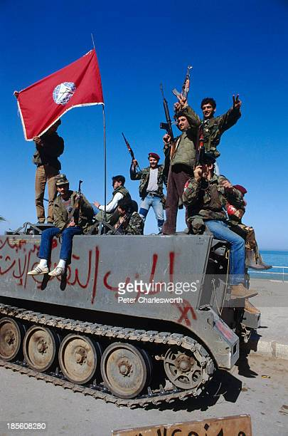 Druze Militiamen celebrate the evactuation of American European and other foreign civilians who are being ferried by US military helicopters to ships...