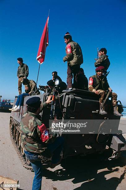 Druze Militiamen watch the evactuation of American European and other foreign civilians who are being ferried by US military helicopters to ships off...