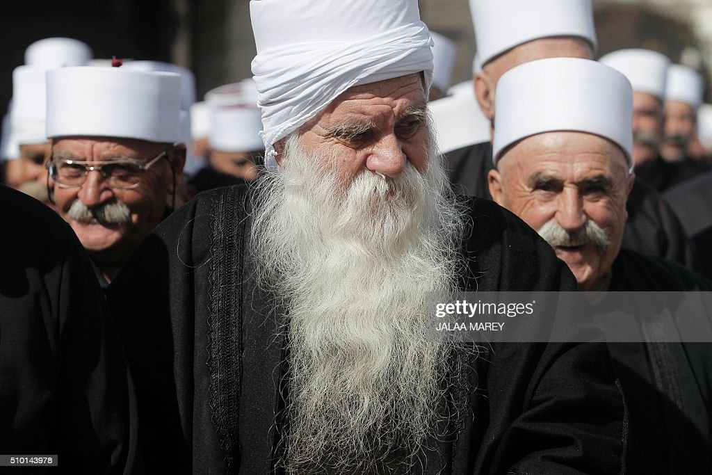 Druze residents of the Buqata village in the Israeli annexed Golan Heights take part in a protest on February 14, 2016 against Israel's annexation of the Golan Heights in 1981. / AFP / JALAA MAREY