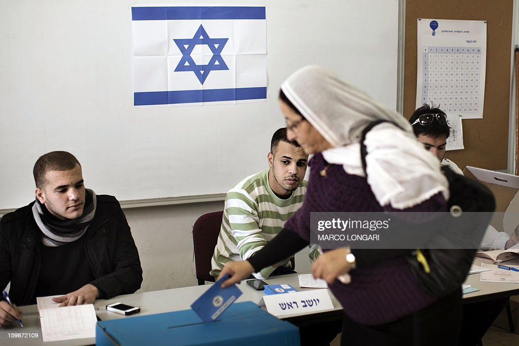 A Druze woman casts her ballot in the northern Israeli village of Maghar January 22, 2013. Israelis voted in elections likely to return Prime Minister Benjamin Netanyahu as head of a rightwing coalition that will face the challenges of peacemaking with the Palestinians and Iran's nuclear programme.
