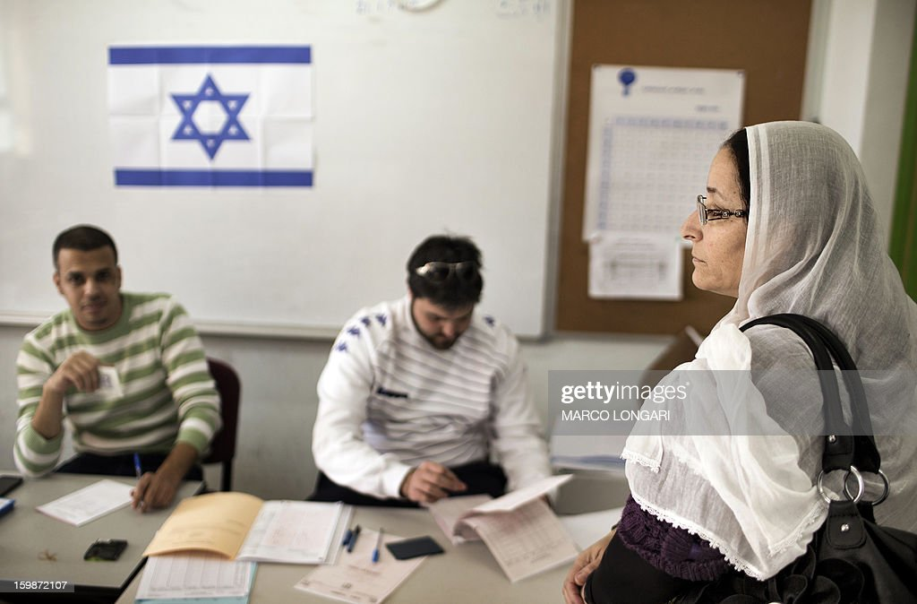 A Druze woman waits to cast her ballot in the northern Israeli village of Maghar January 22, 2013. Israelis voted in elections likely to return Prime Minister Benjamin Netanyahu as head of a rightwing coalition that will face the challenges of peacemaking with the Palestinians and Iran's nuclear programme.