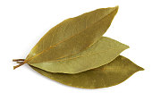 Dry bay leaves (Laurus nobilis) isolated on white background. Top view