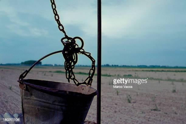 A dry bucket on thirsty farmland