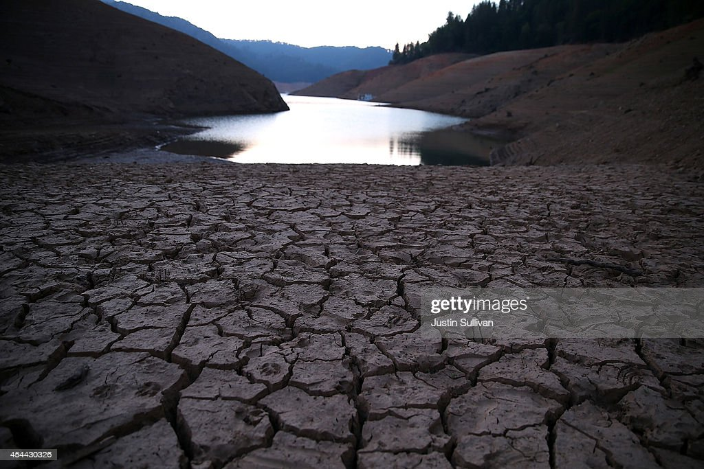 Dry cracked earth is visible on the banks of Shasta Lake at Bailey Cove August 31 2014 in Lakehead California As the severe drought in California...