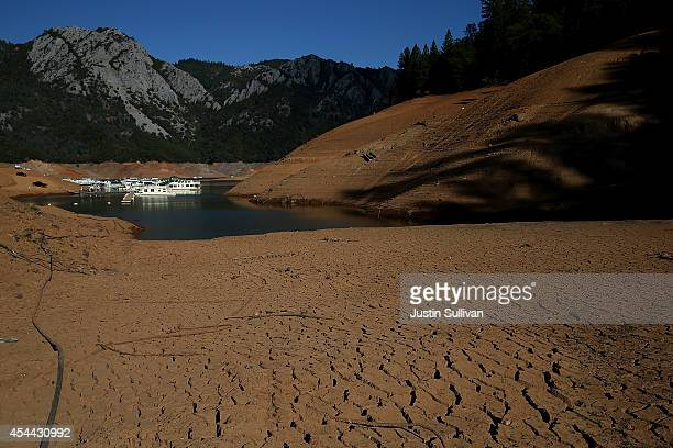 Dry cracked earth is visible on the banks of Shasta Lake at Holiday Harbor on August 30 2014 in Lakehead California As the severe drought in...