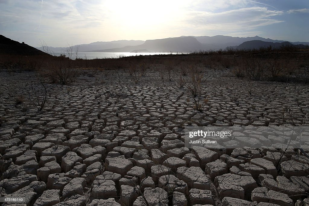 Dry cracked earth that used to be the bottom of Lake Mead is seen near Boulder Beach on May 13 2015 in Lake Mead National Recreation Area Nevada As...