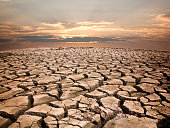 Drought land against sunset background pattern nature.