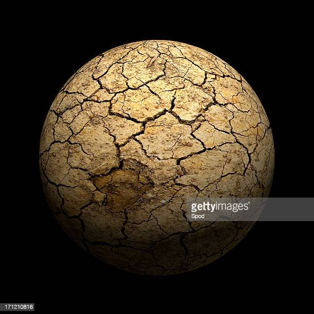 A dry cracked mud sphere on black background
