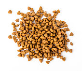 Pile of dry dog food isolated on white background,