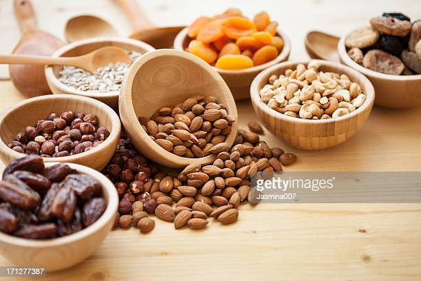 Dry fruits and nuts at wooden table
