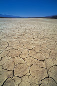 Dry lakebed with cracked mud
