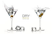 Two dry martini glasses with big splashes. Cocktails isolated on white background. Splash. Template design with sample text