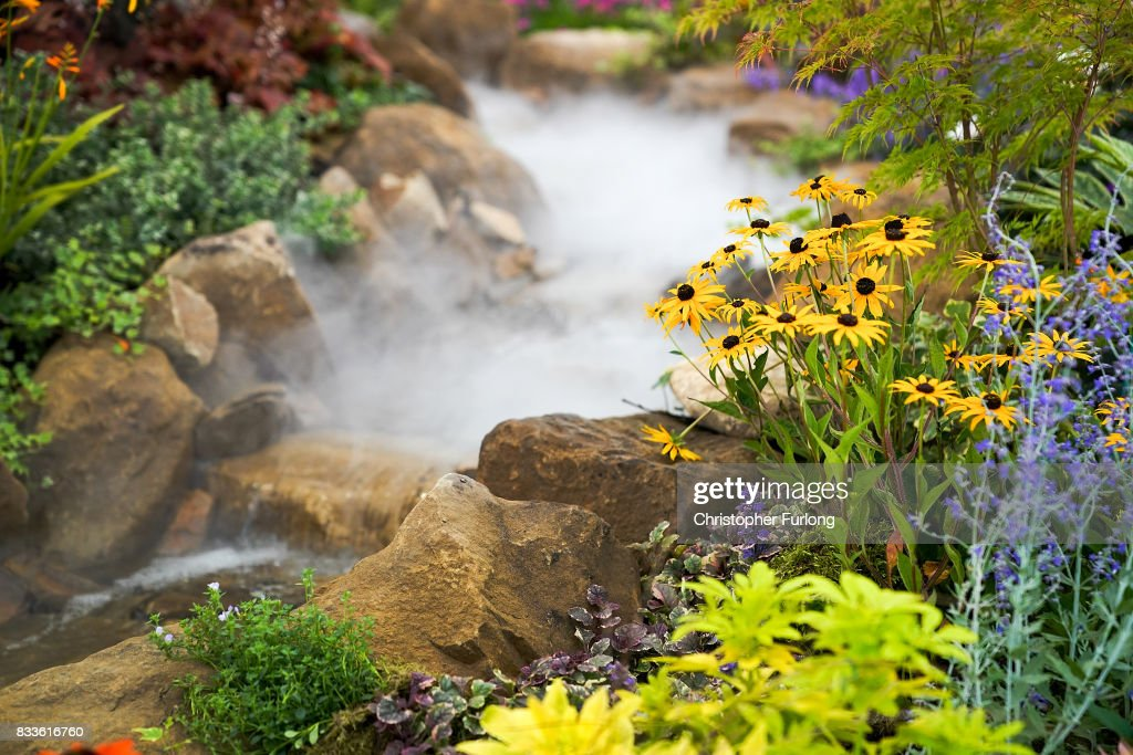 Dry smoke cascades through a flower display at Southport Flower Show on August 17, 2017 in Southport, England. Today is the opening day of Southport Flower Show which is is held over four days. The event is the UK's biggest independent flower show, attracting 80,000 visitors each year to see the flora and fauna at Victoria Park.