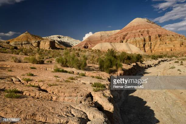 Dry stream bed at red and white Aktau Mountains Altyn Emel National Park Kazakhstan