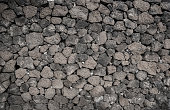 Dry wall constructed from individually stacked lava rocks, typical feature of Lanzarote, Lanzarote, Canary Islands, Spain