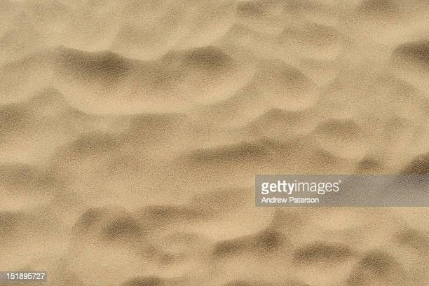 Dry yellow beach sand pattern