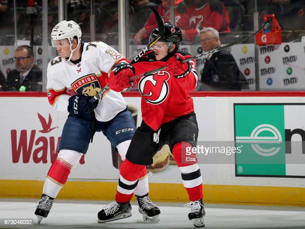 Dryden Hunt of the Florida Panthers and Nico Hischier of the New Jersey Devils fight for position in the first period on November 11 2017 at...