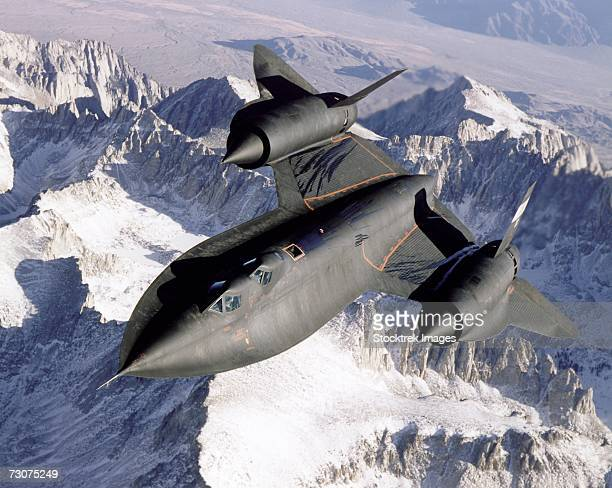 Dryden's SR-71B, NASA 831, slices across the snowy southern Sierra Nevada Mountains of California after being refueled by an Air Force Flight Test Center tanker during a recent flight.